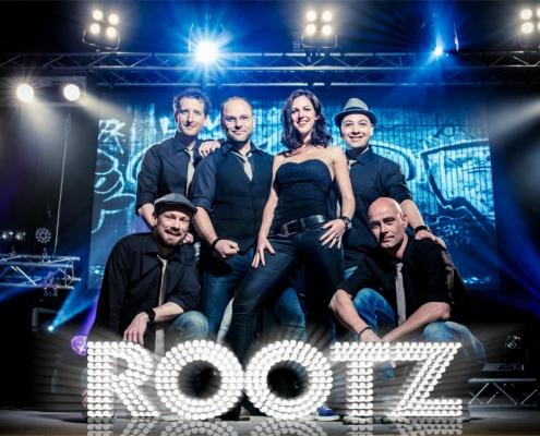 Persfoto van coverband bands feestband boeken bruiloft band boeken coverband RootZ
